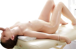 Sexy brunette lassie enjoys a massage..